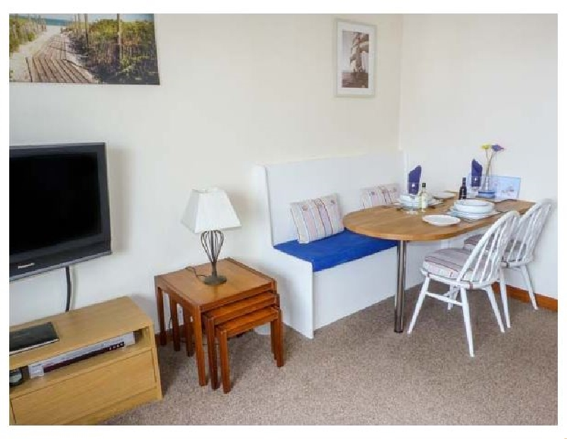 Click here for more about Troon Apartment